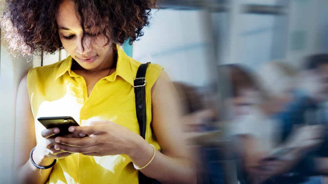 woman-using-phone-train